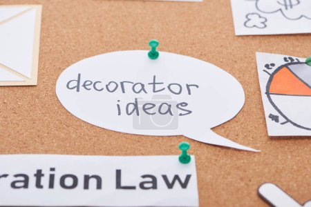 Photo for Paper card with decorator ideas text pinned on cork office board - Royalty Free Image