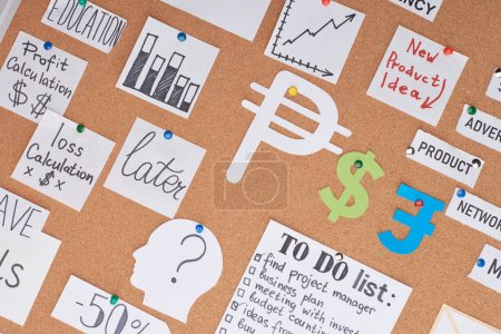 Photo for Top view of cards with work financial notes pinned on office cork board - Royalty Free Image