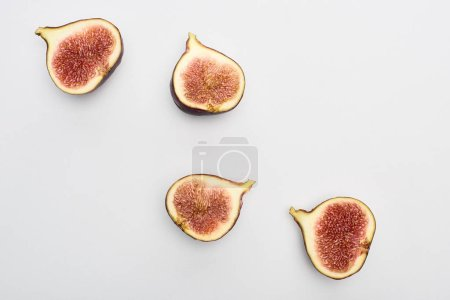 Photo for Top view of ripe cut tasty figs on white background - Royalty Free Image