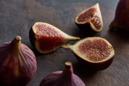 Photo for Ripe whole and cut delicious figs on stone background - Royalty Free Image