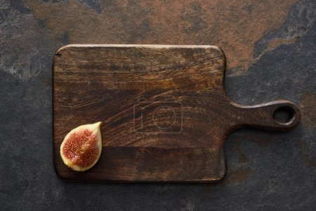 Photo for Top view of ripe cut delicious fig on cutting board on stone background - Royalty Free Image