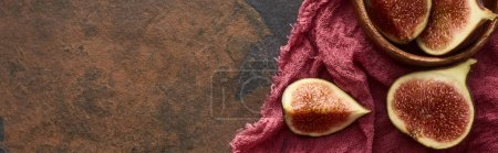 Photo for Panoramic shot of ripe cut delicious figs in wooden bowl on rustic red cloth on stone background - Royalty Free Image