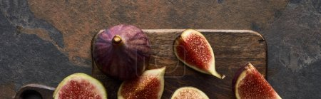 Photo for Panoramic shot of ripe fresh delicious figs on cutting board on stone background - Royalty Free Image