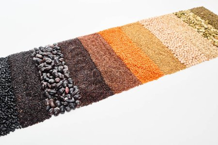 Photo for Black beans, rice, quinoa, chickpea, pumpkin seeds, buckwheat, maash and red lentil isolated on white - Royalty Free Image