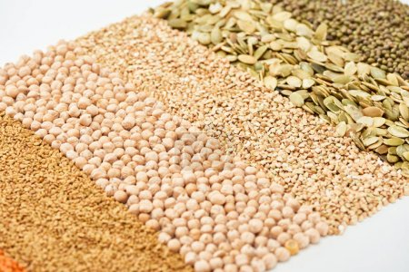 Photo for Raw chickpea, buckwheat, maash and pumpkin seeds isolated on white - Royalty Free Image
