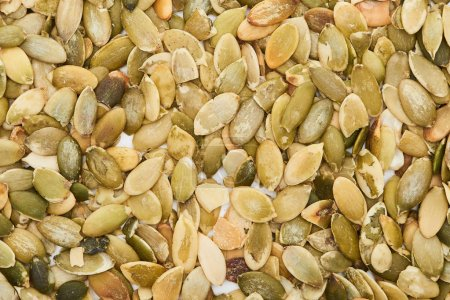 Photo for Top view of tasty roasted organic pumpkin seeds - Royalty Free Image