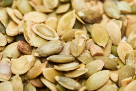 Photo for Close up view of tasty organic pumpkin seeds - Royalty Free Image