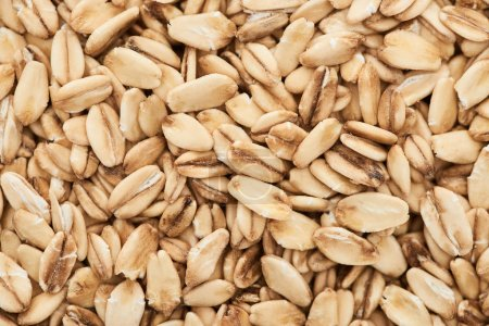 Photo for Top view of unprocessed pressed organic oats - Royalty Free Image