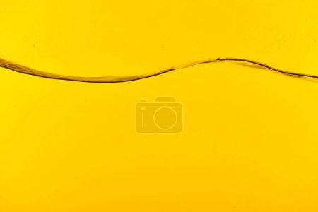 Photo for Wavy clear fresh water on yellow bright background - Royalty Free Image