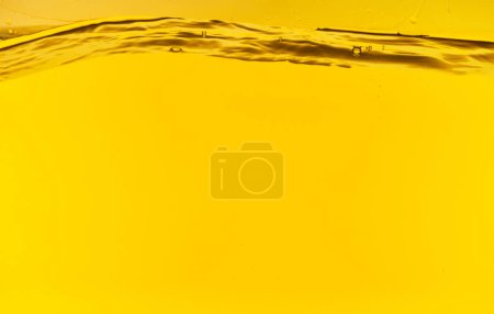 Photo for Wavy clear deep water on yellow bright background - Royalty Free Image