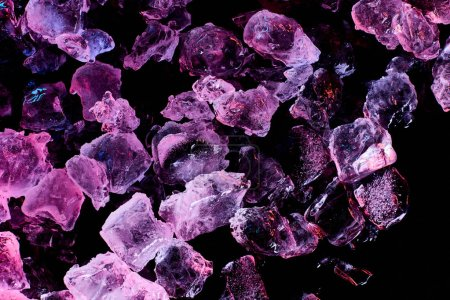 Photo for Top view of ice cubes with purple lighting isolated on black - Royalty Free Image