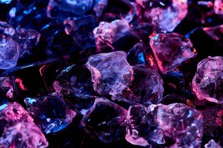 Photo for Transparent ice cubes with purple illumination isolated on black - Royalty Free Image