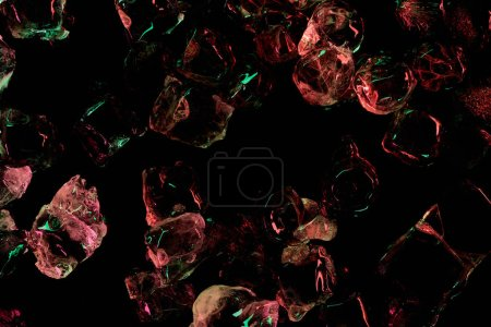 top view of ice cubes with red and green illumination isolated on black