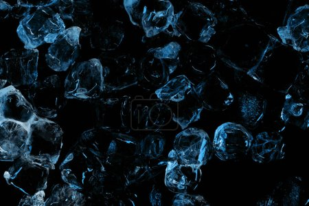 Photo for Top view of frozen clear ice cubes with blue lighting isolated on black - Royalty Free Image