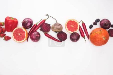 Photo for Top view of raw red and purple autumn vegetables, berries and fruit on white background - Royalty Free Image