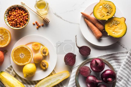 Photo for Top view of plates with season autumn vegetables and fruits on marble surface - Royalty Free Image