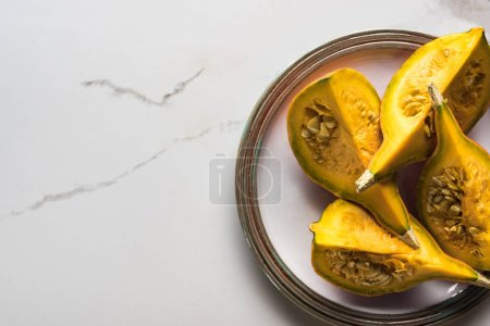 top view of plate with pumpkin parts on marble table