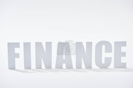 finance word with shadows on white background