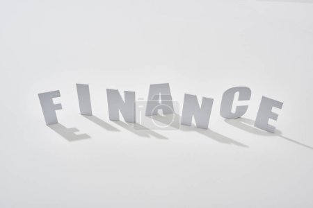 Photo for Finance lettering with shadows on white background - Royalty Free Image