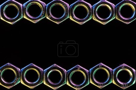 Photo for Close up view of shiny metal nuts rows isolated on black - Royalty Free Image