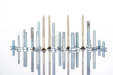 Photo for Shiny metallic studs and bolts isolated on white - Royalty Free Image
