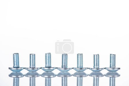 close up view of shiny short bolts isolated on white with copy space