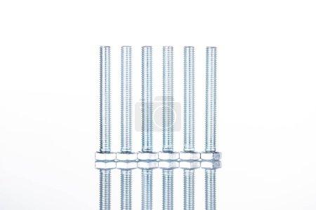 Foto de Vista de cerca de pernos largos brillantes aislados en blanco con espacio de copia - Imagen libre de derechos