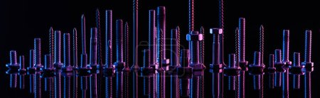 Photo for Panoramic shot of diverse purple metallic screws isolated on black - Royalty Free Image