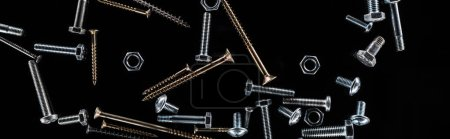 Photo for Panoramic shot of scattered bolts, nuts and studs isolated on black - Royalty Free Image