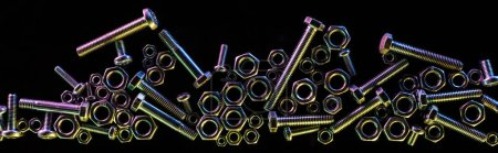 panoramic shot of scattered steel bolts and nuts isolated on black