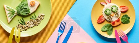Photo for Top view of plate with fancy animals made of food on blue, yellow and pink background - Royalty Free Image