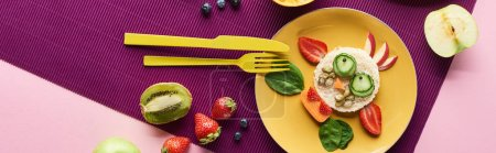 Photo for Top view of plate with fancy cow made of food near fruits on purple background, panoramic shot - Royalty Free Image