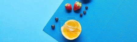 Photo for Top view of fresh fruits on blue background, panoramic shot - Royalty Free Image