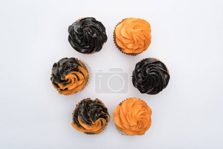 Photo for Top view of delicious Halloween cupcakes in circle isolated on white - Royalty Free Image