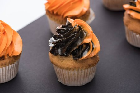 Photo for Delicious Halloween cupcakes with black and orange cream - Royalty Free Image