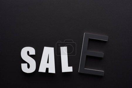Photo pour Top view of sale lettering on black background - image libre de droit