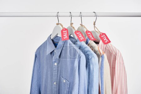 Photo for Elegant shirts hanging with sale labels isolated on white - Royalty Free Image
