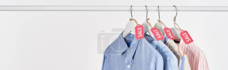 Photo for Elegant shirts hanging with sale labels isolated on white, panoramic shot - Royalty Free Image