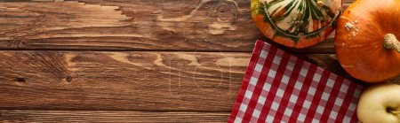 Photo for Panoramic shot of checkered tablecloth with ripe apples and pumpkins on wooden surface with copy space - Royalty Free Image