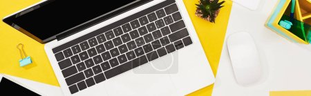 Photo for Top view of laptop with blank screen and computer mouse on yellow and white background - Royalty Free Image