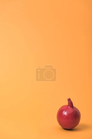 Photo for Painted red pumpkin on orange colorful background - Royalty Free Image