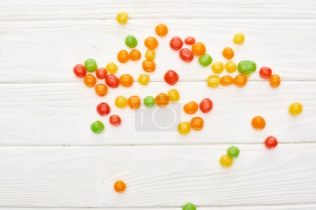 Photo for Top view of colorful bonbons on white wooden table, Halloween treat - Royalty Free Image