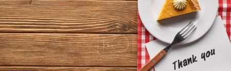 Photo for Top view of tasty pumpkin pie and thank you card on plaid napkin on wooden rustic table, panoramic shot - Royalty Free Image