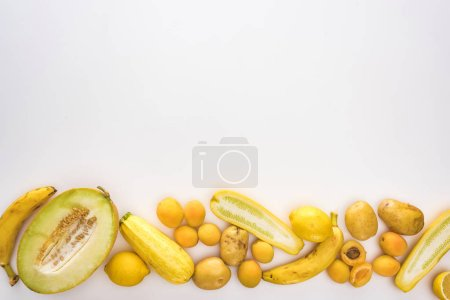Photo for Top view of yellow fruits and vegetables on white background with copy space - Royalty Free Image