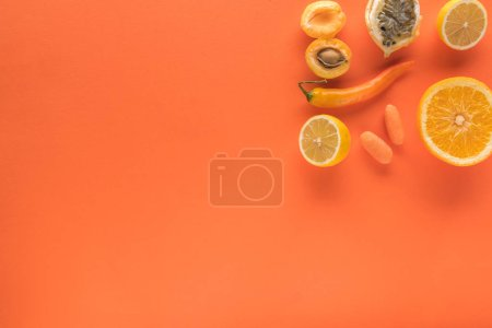 Photo for Top view of yellow fruits and vegetables on orange background with copy space - Royalty Free Image