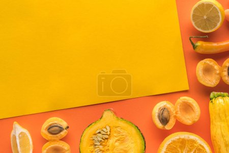 Photo for Top view of fresh fruits and vegetables on yellow and orange background with copy space - Royalty Free Image