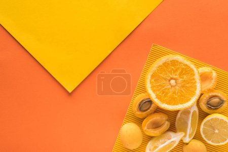 Photo for Top view of yellow fruits on yellow and orange background with copy space - Royalty Free Image