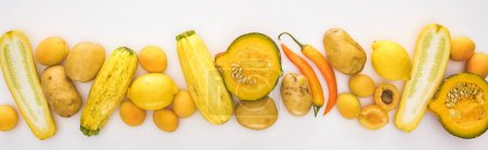 Photo for Top view of yellow fruits and vegetables on white background with copy space, panoramic shot - Royalty Free Image