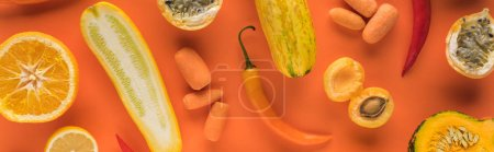 Photo for Top view of yellow fruits and vegetables on orange background, panoramic shot - Royalty Free Image