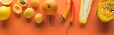 Photo pour Top view of yellow fruits and vegetables on orange background, panoramic shot - image libre de droit